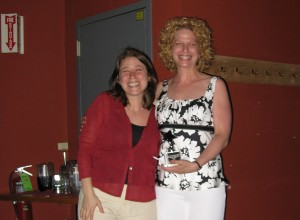 AWIS-CAC President Heather Behanna (left) and award recipient Dr. Holly Falk-Krzesinski (right).